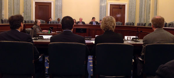 "Susan Eisenhower (seated third from left) delivers verbal testimony to Senators Bill Nelson and Marco Rubio at the ""From Here to Mars"" hearing on April 9, 2014."